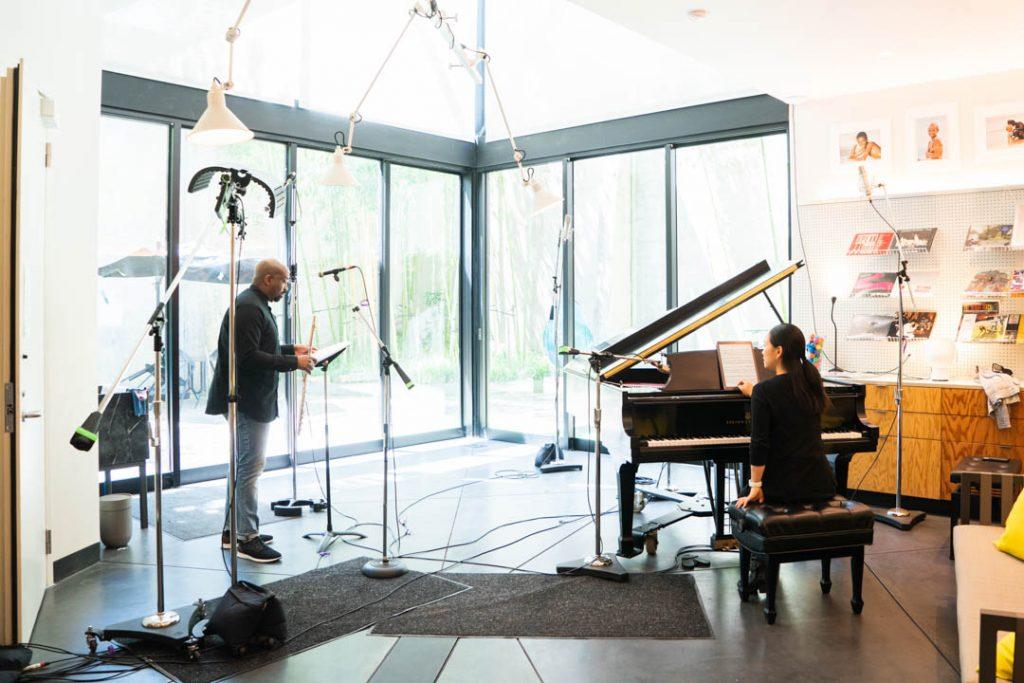 two musicians in a recording studio