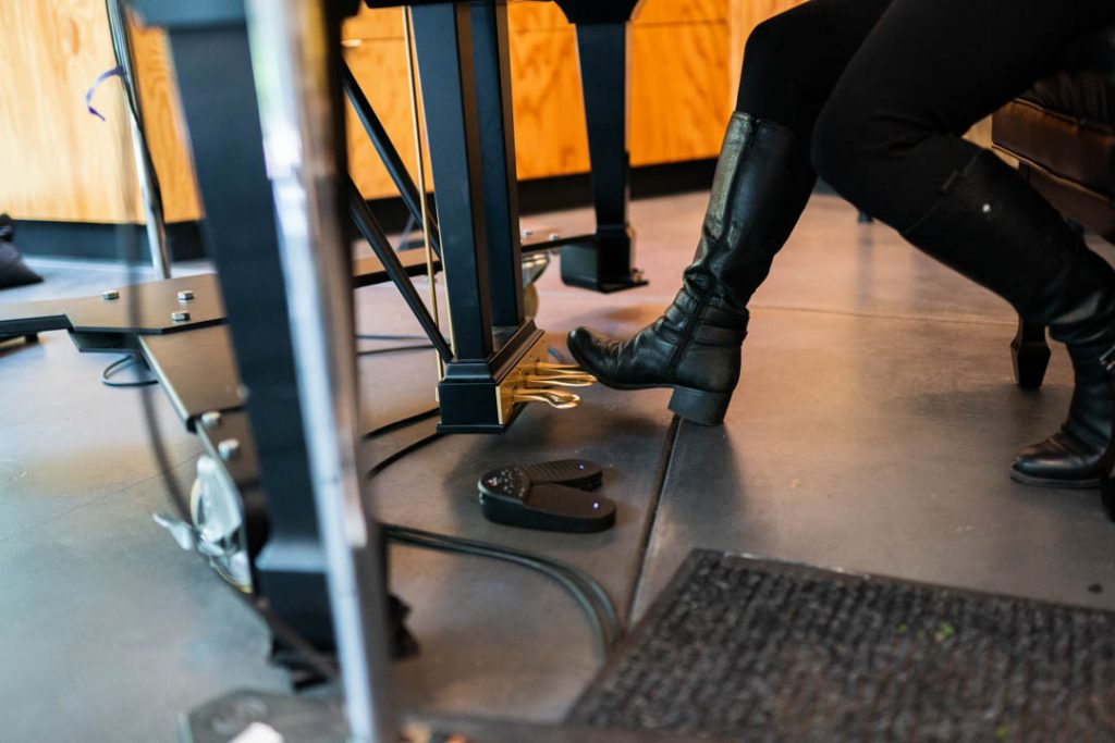a foot above piano pedals