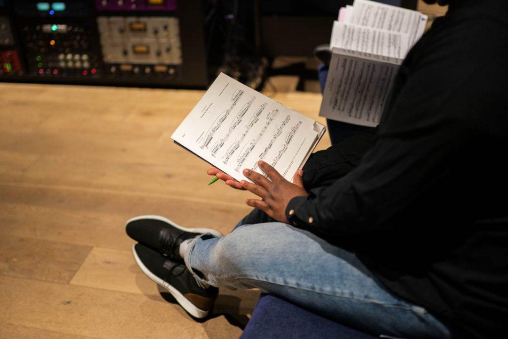a man reading sheet music