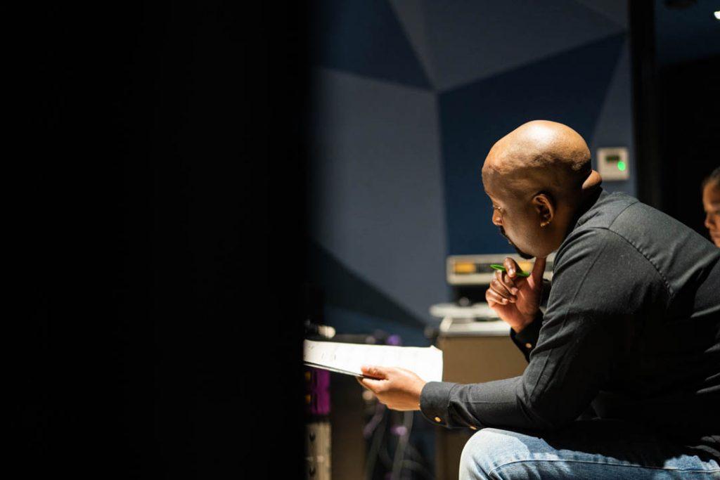 a man looking at sheet music